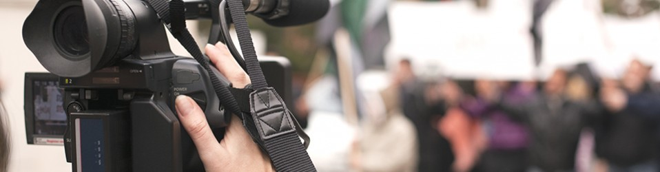 Journalists' Cameras and Social Control